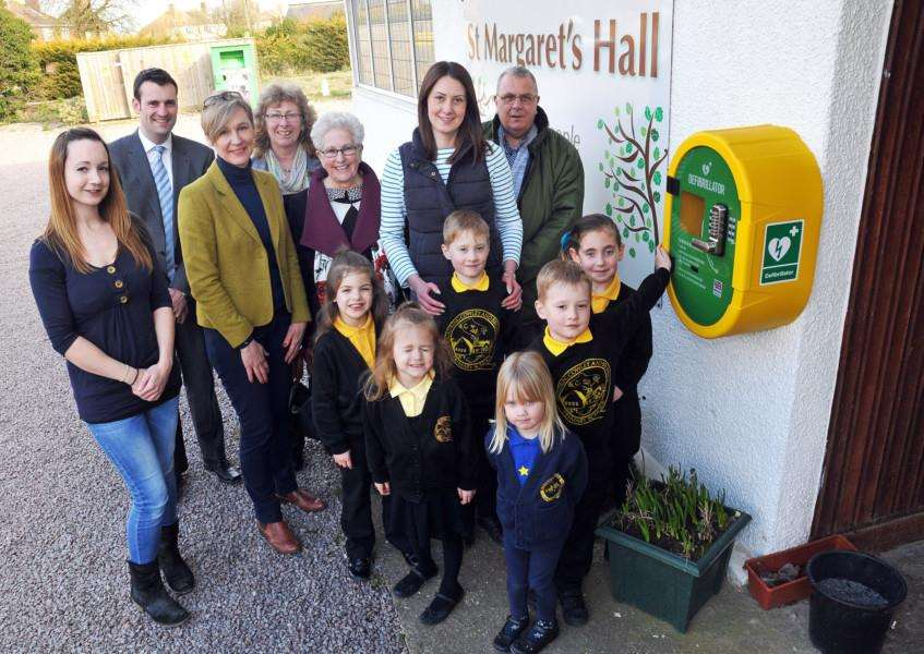 Pupils from Quadring Cowley and Brown's Primary School, parents, staff, guests and members of Quadring WI with the new defibrillator outside St Margaret's Hall. Photo by Tim Wilson. SG260318-121TW.