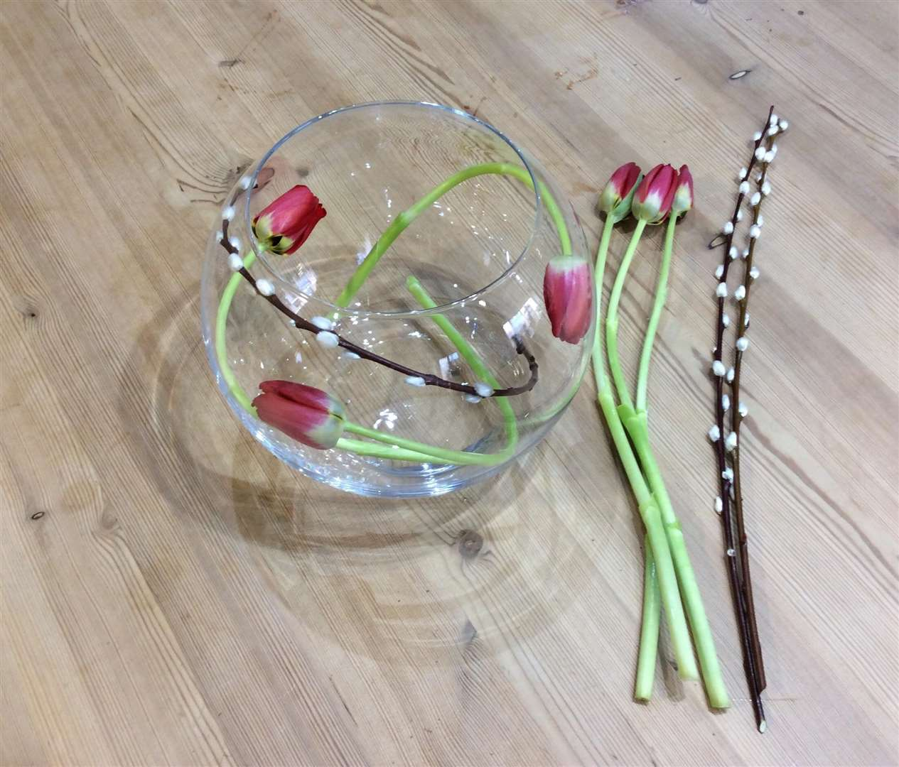Arrange your tulips and willow inside the bowl.