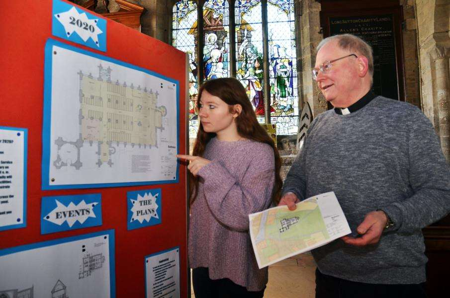 Father Jonathan Sibley and his daughter Shona, with the plans for improvements to the church. SG050418-116TW