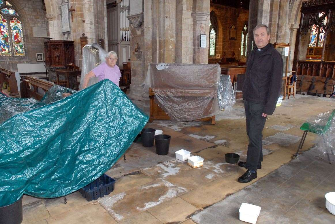 The Rev Ian Walters and churchwarden Iris Bennett pictured inside the church in September