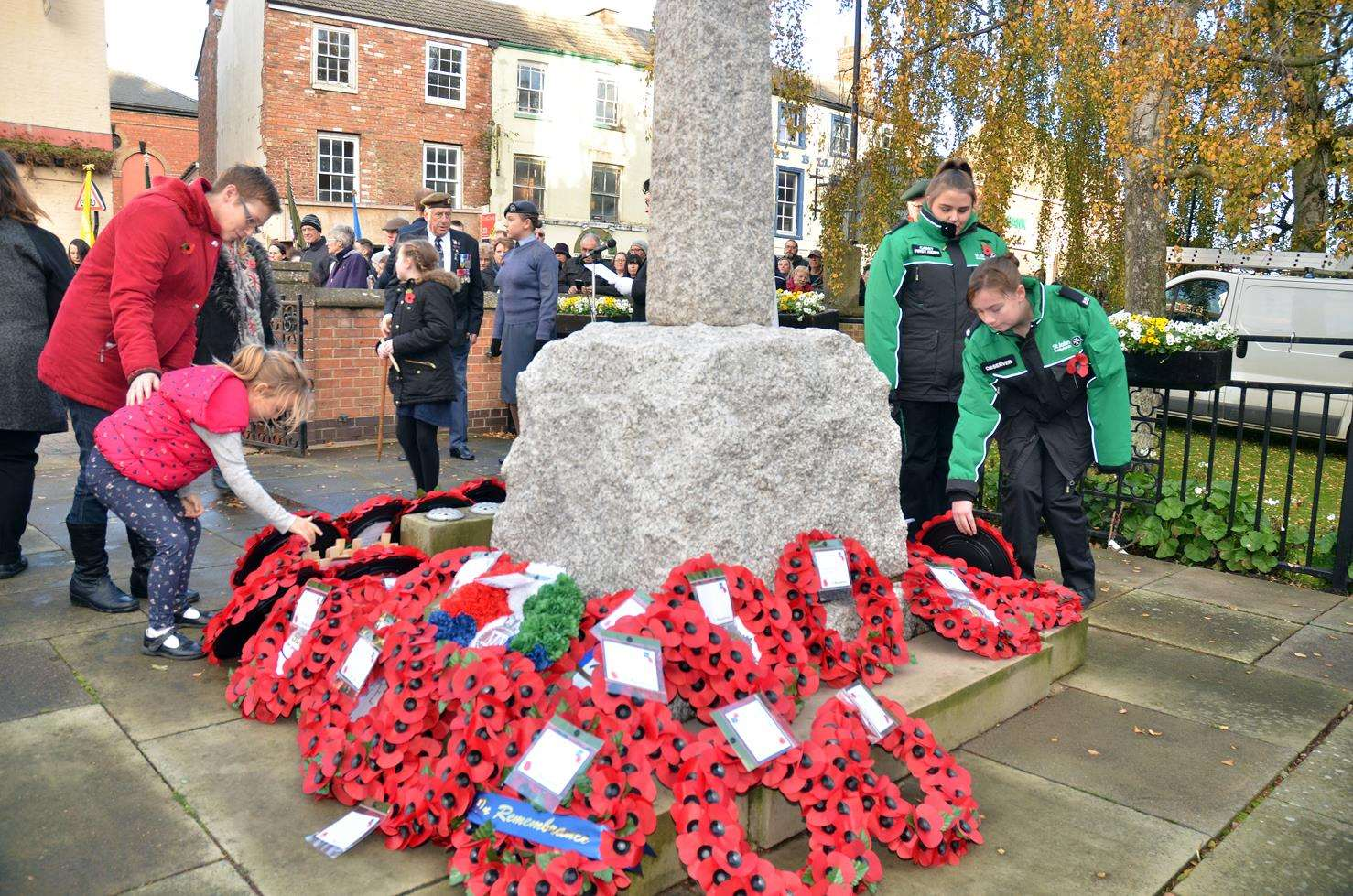 A child lays a wreath at Holbeach War Memorial outside All Saints Church.Photo by Tim Wilson.SG-111118-179TW