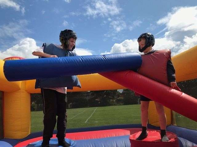 Pupils at The Priory School enjoyed inflatable gladiator bouts.