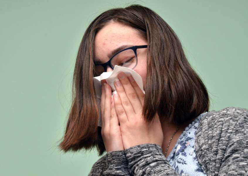 Help prevent the spread of TB by using a tissue to cover sneezes and coughs. (Photo posed by model).