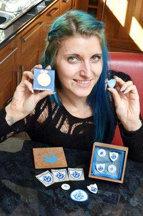 Laura Hudson with her Blue Peter badges, including her 40th anniversary gold medallion and home-made wooden case to keep it safe. (SG081018-005).