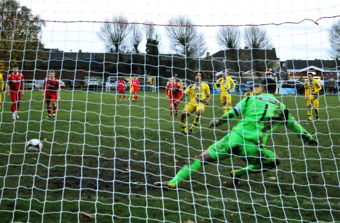 Jamie Jackson slots home Spalding's second-half equaliser from the penalty spot.