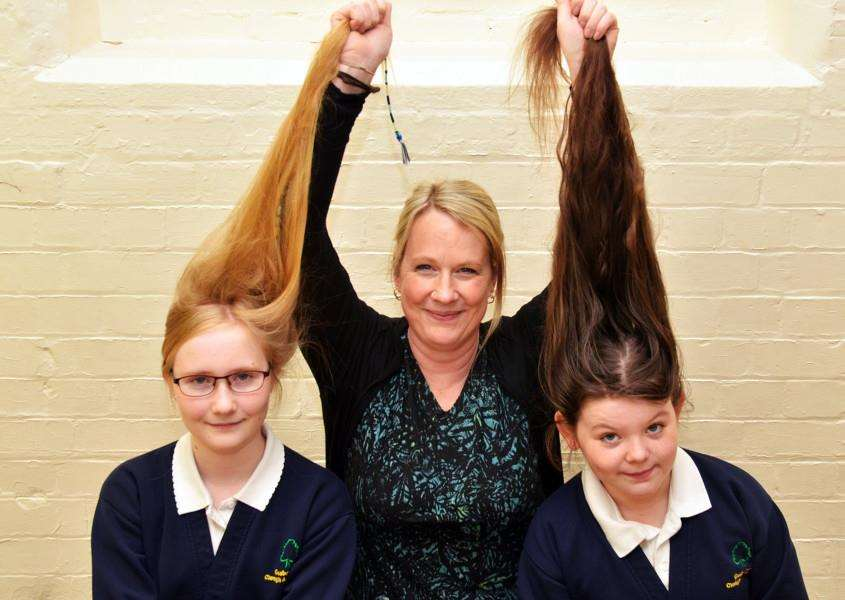 Gosberton Clough and Risegate School, girls with long hair'Alex-ava Hitchens (10) and Natalie Greenhalgh (11 blonde hair) with Tracy Greenhalgh