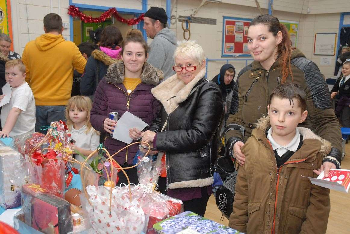 Children, parents and grandparents look at the Christmas hamper raffle.Photo by Tim Wilson.SG-061219-070TW.