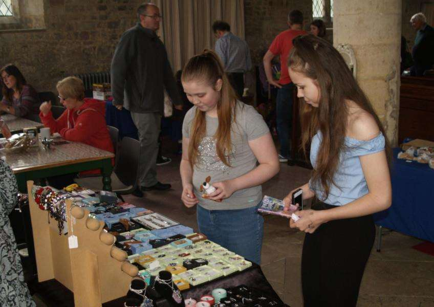 Youngsters look at the jewellery stall.