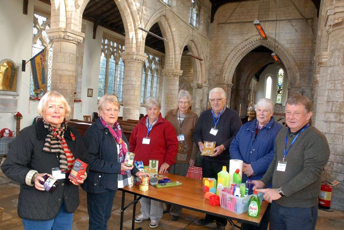 Coordinator Janet Mossman, churchwarden Janice Despicht, volunteers Chris Mason, June and Bob Greenslade, Rosemary Goddard and project manager Trevor Baily at Sutterton Foodbank inside St Mary's Church.SG-081119-002TW.