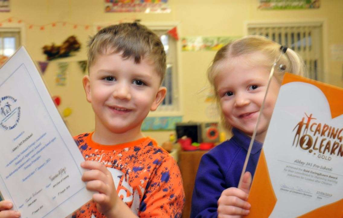 Zachary and Ebbi with the National Portage Association 'Stamp of Approval' accreditation and Caring2Learn award respectively given to Abbey 345 Pre-School, Crowland.Photo by Tim Wilson.SG-121219-024TW.