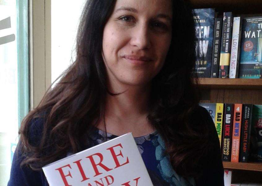 Sam Buckley, manager at Bookmark in Spalding with the book Fire and Fury.