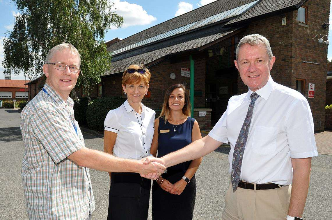 Munro Medical Centre, West Elloe Avenue, Spalding, pic of Anthony Cronin (MMCPPG) and Dr Graham Wheatley, Anthony Cronin, reception manager Debbie Barton, operations manager Lisa Jones (3431787)