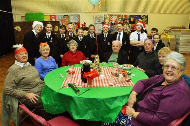 Pupils and pensioners at last year's meal. (5584845)