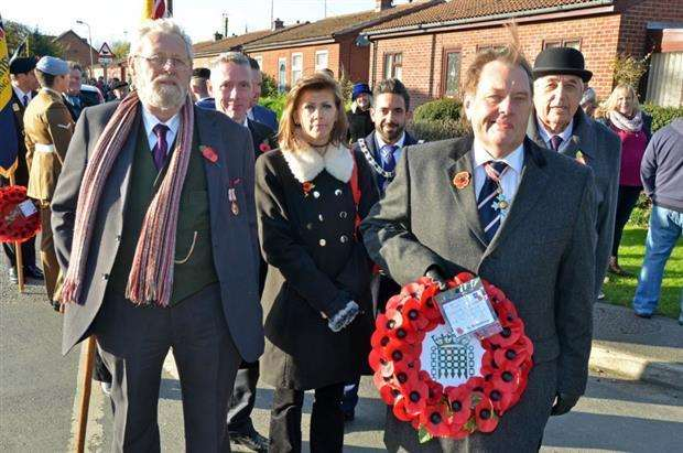 John Hayes, MP for South Holland and the Deepings, with South Holland District Council members Couns Paul Foyster, Andrew Woolf, Tracey Carter, vice chairman Harry Drury and Francis Biggadike, at the Remembrance Sunday parade in Holbeach. Photo by Tim Wilson.