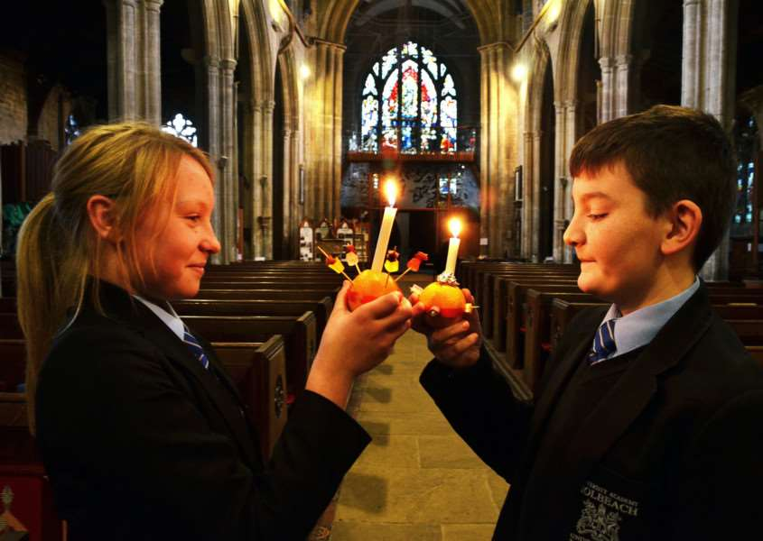 Selena Langley and Jacob Breden at the Christingle service at Holbeach All Saints Church. (SG111217-127TW)