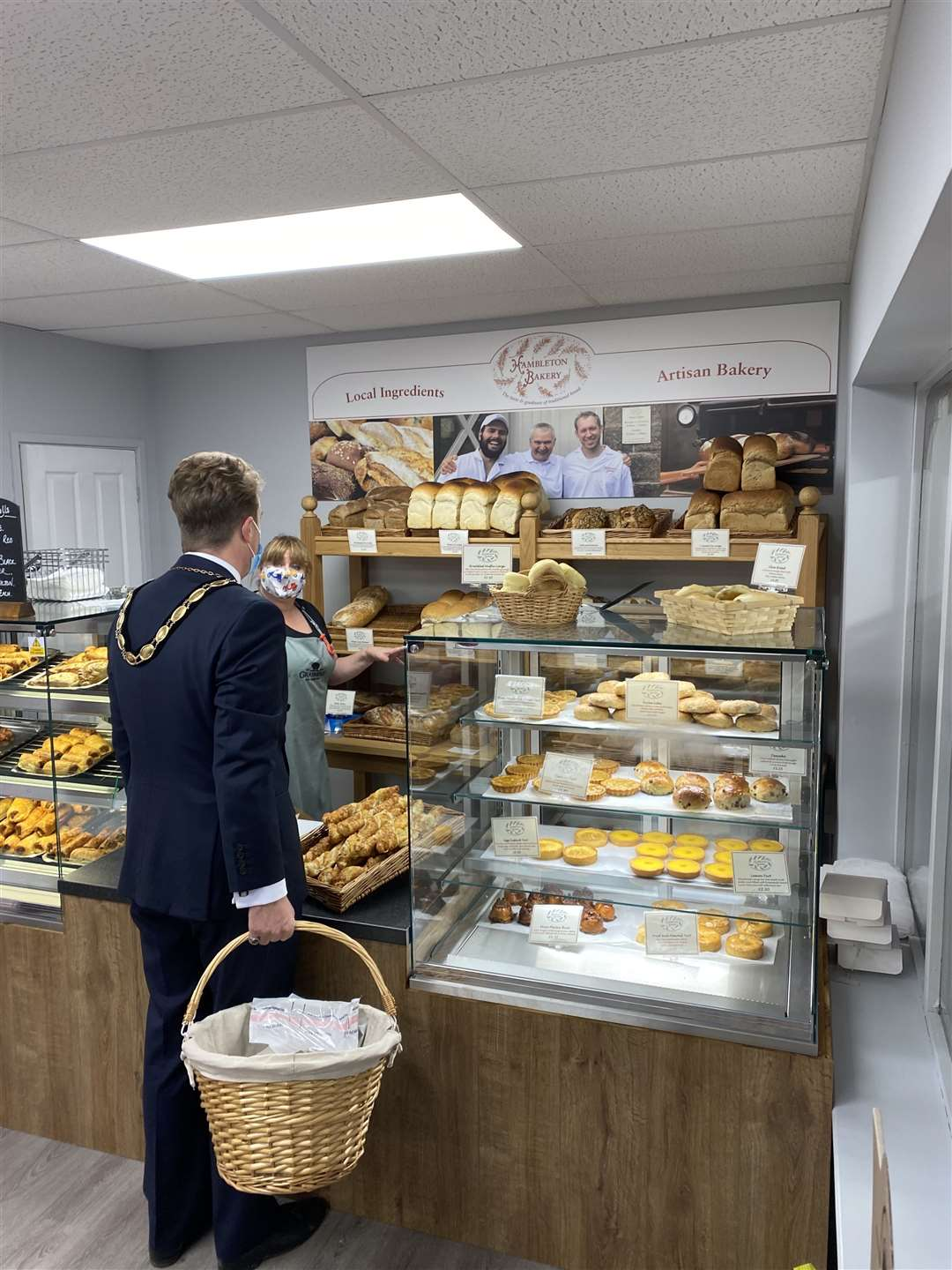Market Deeping Mayor Josh Yarham shopping in the deli and being served by deli manager Fiona Andrews. Photo: Will Bowell/Grasmere Farm.
