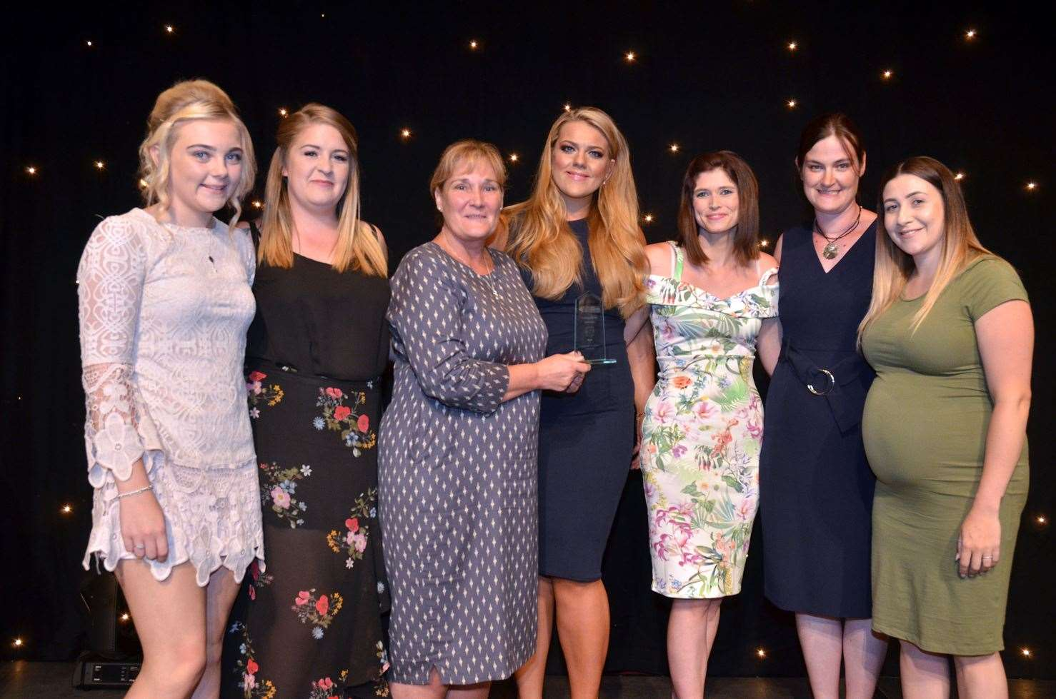Staff from Cinder Ash Pre-School, Long Sutton, with Suzie Bulbeck (third left), director of 2018 Pre-School of the Year award sponsors Riverside Training. Photo (TIM WILSON): 050718108SG.