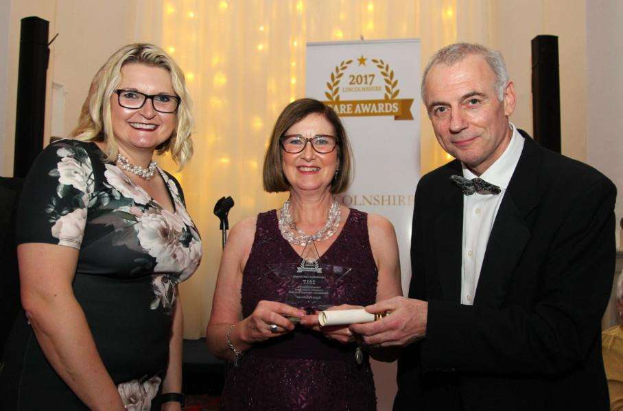 Susan Palethorpe received her award from Glen Garrod, Executive Director of Adult Care and Community Wellbeing at Lincolnshire County Council, and award sponsor Dr Sharon Black from the University of Lincoln
