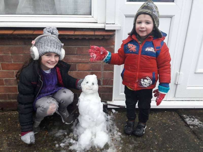 Emily (9), Matthew (2) with their snowman in Crown Drive, Spalding. Photo: Kelly Taylor