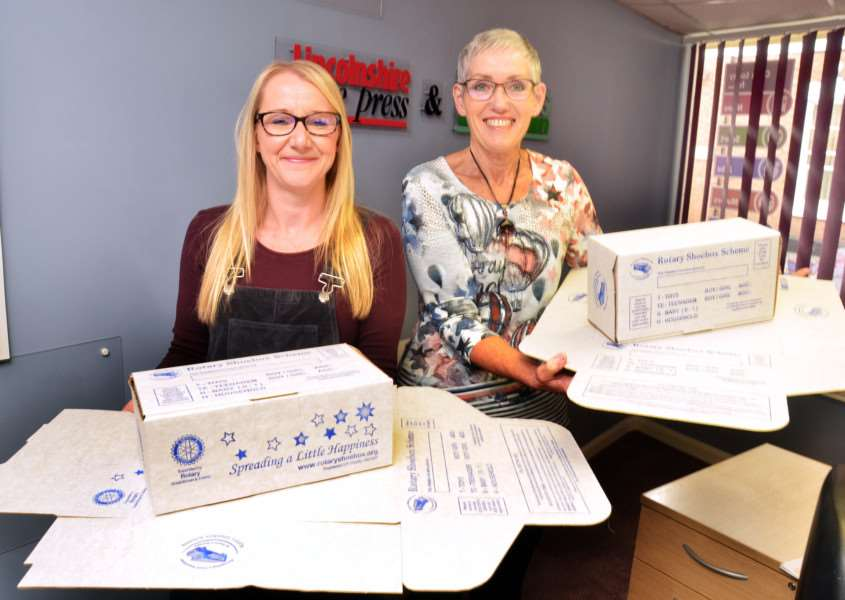 Free Press receptionists Leeann Hodson and Linda Lovell with the Rotary shoeboxes. SG021017-100TW