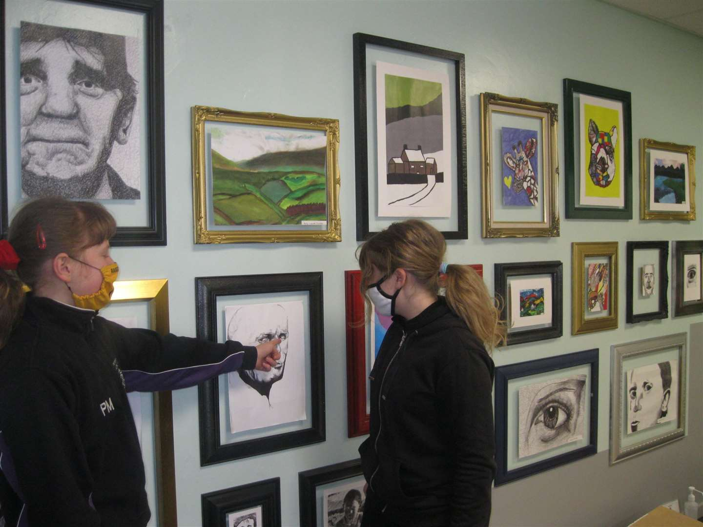 Poppy Martin and Madeleine Almey were discussing the art work on display at University Academy Long Sutton (44362189)